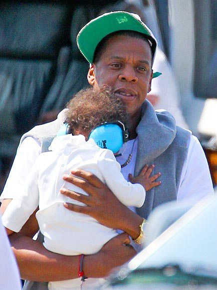 WATCH THE THRONE She's Daddy's little girl, no doubt! Jay-Z keeps 8-month-old daughter Blue Ivy Carter protected after arriving in New York City by helicopter on Thursday.