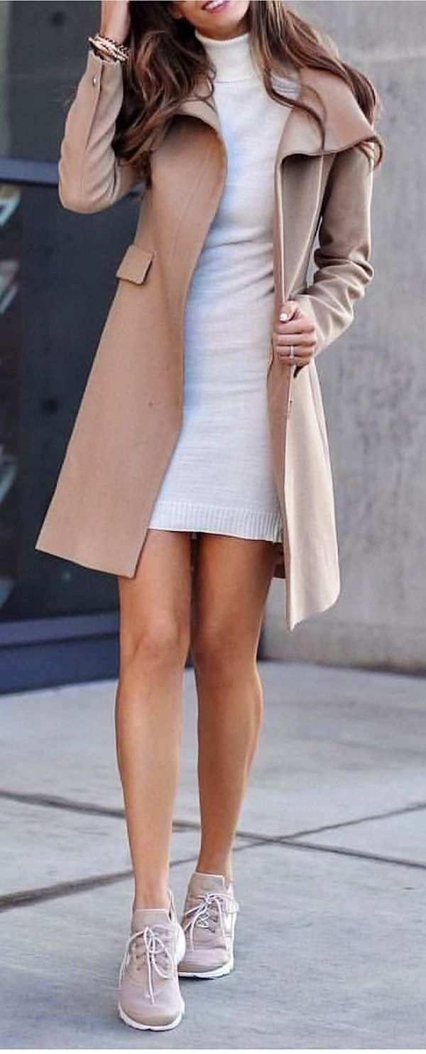 #spring #outfits  woman in beige coat and gray dress standing on pathway. Pic by…