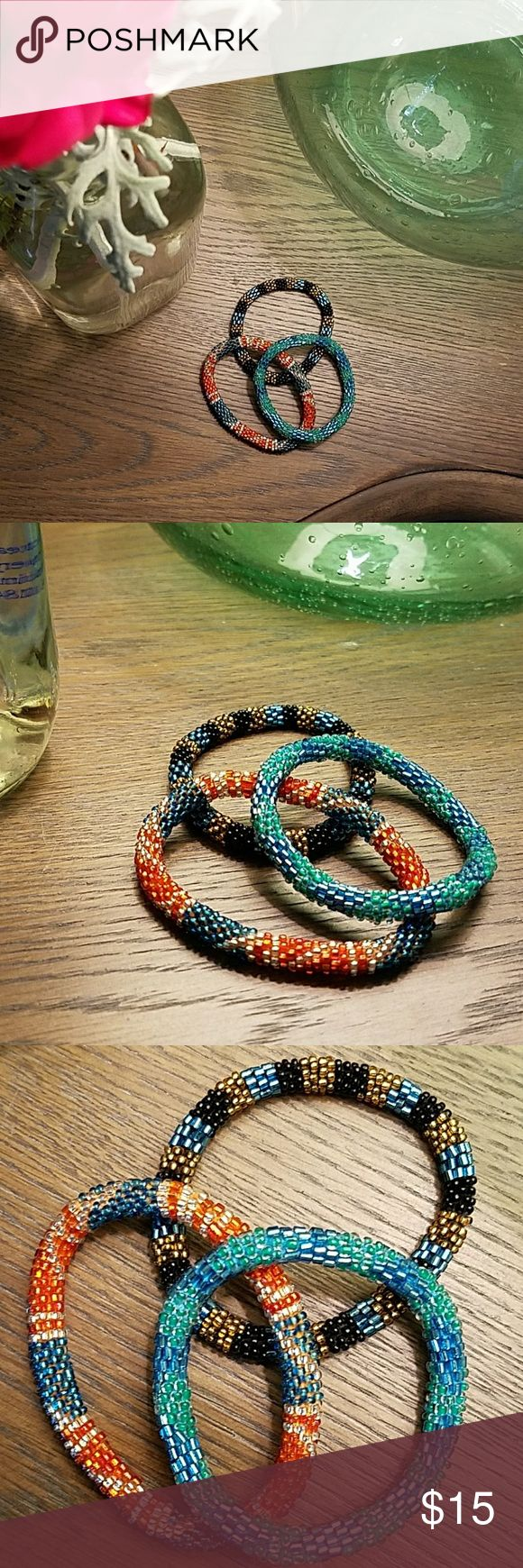 Set of 3 beaded bracelets? These are cool beaded bracelets I bought that help support women in Nepal. Beautiful craftsmanship. NWOT Jewelry Bracelets