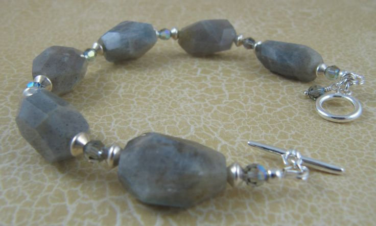 Bracelet with labradorite chunks, Swarovski crystals, and sterling silver spacers and findings.