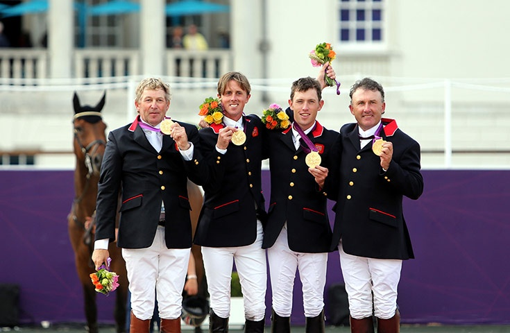 Great Britain's Nick Skelton, Ben Maher, Scott Brash and Peter Charles celebrate with their Gold medals after the Equestrian Team Jumping. Congratulations