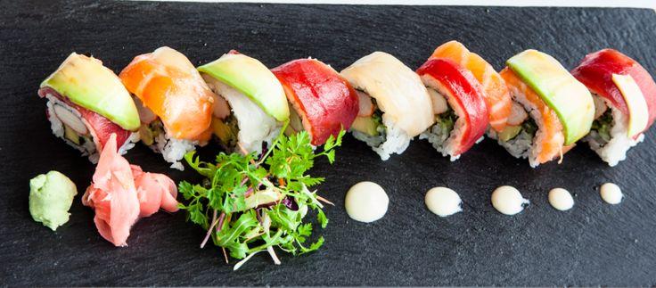 St Tropez Rainbow Roll: California Roll layered with thin Sashimi style slices of Tuna, Salmon, Hamachi & Avocado