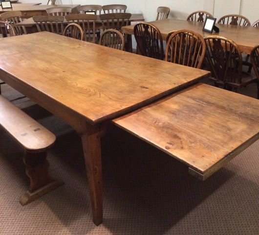 Large Antique Elm farmhouse table with tapered legs and large bread slide.