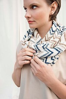 Dynamic various size chevrons in a melange of colors create movement in this chic cowl. Tweedy Pebble facilitates visual texture when contrasted with the smooth super baby alpaca halo of Cima. Knit as a single piece and joined end to end, the possibilities for variation are infinite.