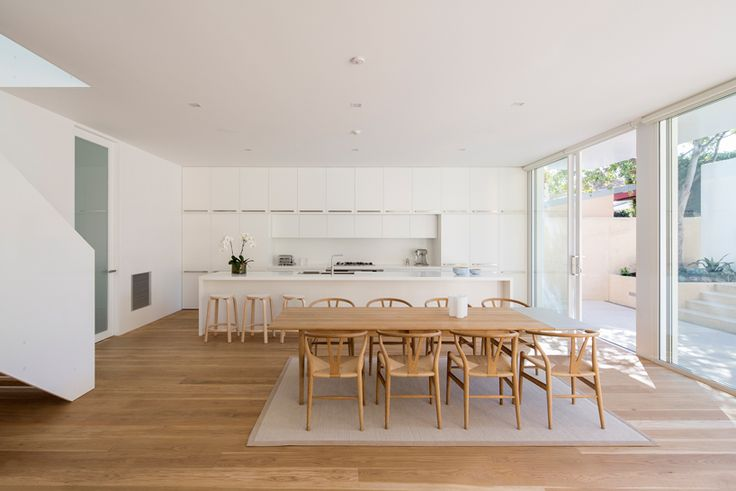 ian moore adds white-framed contemporary extension to sydney bungalow