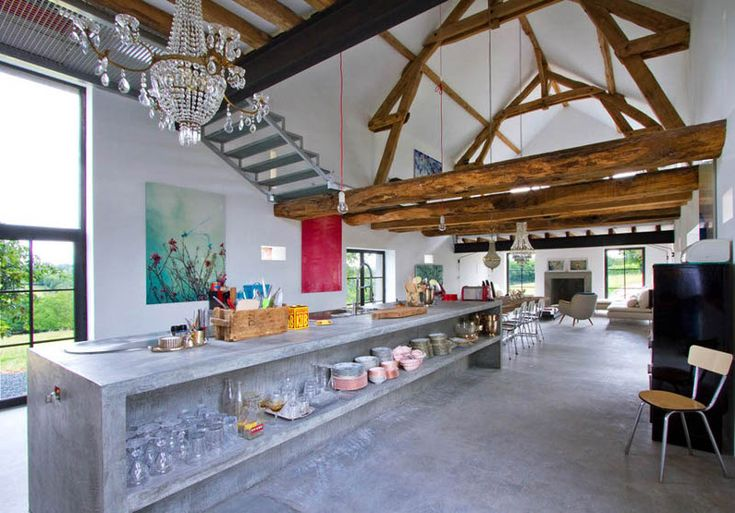 Rustic barn meets exuberance and style. Quirky meets practicality. Concrete and chandeliers, modern art and aged oak beams.