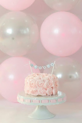 First birthday cake smash- pink rosette cake... this would be perfect, especially if we have a baby girl and plan to name her Rosalie or Roslin. <3 :)