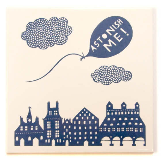 Rob Ryan - 'Ashtonish Me' Ceramic Tile.    Hand screenprinted in blue this tile reads - Astonish Me!    Measures 14.8cm X 14.8cm