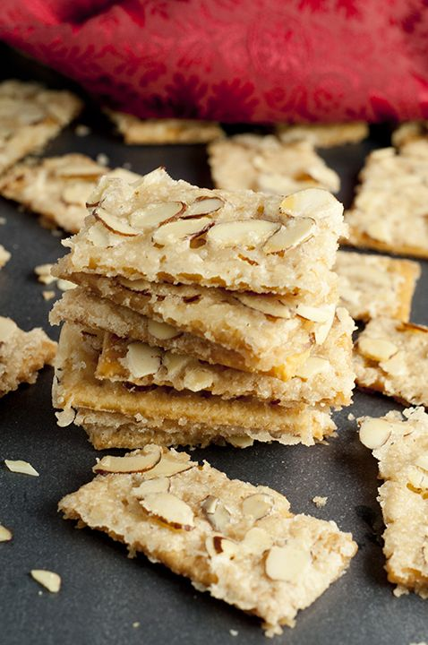 Almond Club Cracker Toffee recipe is salty crackers coated in a sweet toffee sauce and slathered with almonds. This will be your new favorite easy holiday go-to treat!