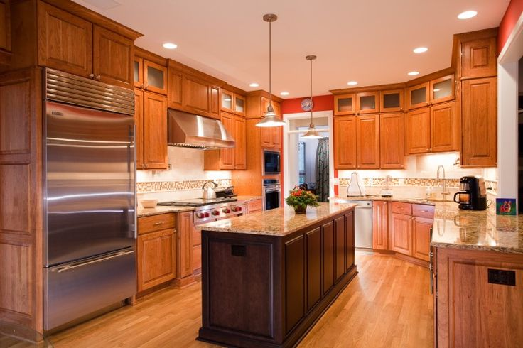 Kitchen Wow Walnut Kitchen Theme Decoration With Stainless Steel Kitchen Appliance Freestanding Icebox Freezer Also Stainless Range Hood And Stainless Built In Oven Besides Cheryy Kitchen Island  Marble Countertop  Laminated Wooden Floor   Best Tips About Finding The Best Kitchen Appliances