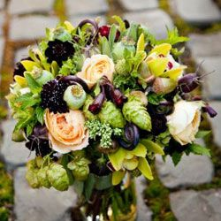 Simply stunning - this bridesmaid bouquet features garden roses, fiddlehead ferns, scabiosa, chocolate cosmos, and orchids