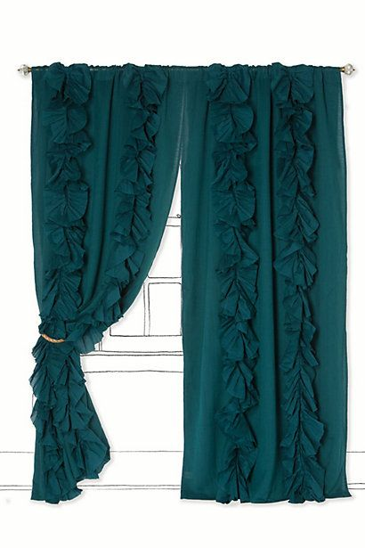 Take the navy blue curtains you have, pull the color out, re-dye this luscious peacock blue, and add on some ruffles for texture! Totally awesome for the guest bedroom!