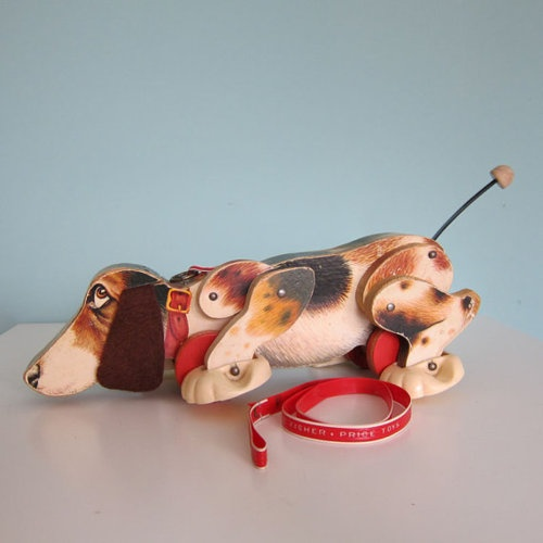 Home: Eleven Vintage Toys For Your Favourite Kidlet  (via Vintage Fisher Price Snoopy Dog Pull Toy by RetroGirlRedux on Etsy)