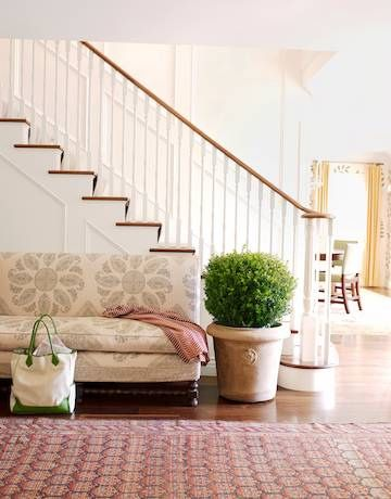 entryway ~ LOVE the couch and planter!