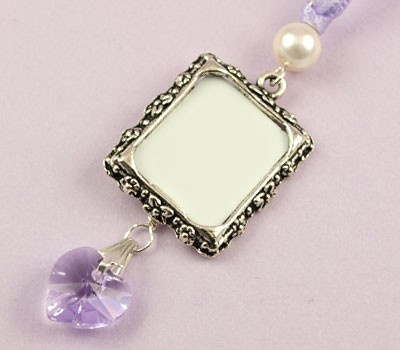 The Heart Photo Frame wedding charm is a pretty way to remember a loved one at your wedding, simply place their photo into the frame and hang the charm from your bouquet. Available in gold, antique gold or antique silver and a fabulous range of bead and ribbon colours.