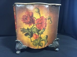 VICTORIAN STYLE FOOTED METAL WASTE BASKET WITH DECORATIVE FLOWERS. MEASURES 7 INCHES IN HEIGHT AND SHOWS SOME WEAR