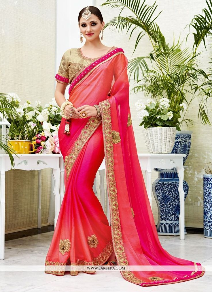 Add a vibrant burst of color in your wardrobe with this hot pink art silk and faux chiffon shaded saree. The amazing dress creates a dramatic canvas with embroidered, lace and zari work. Comes with ma...