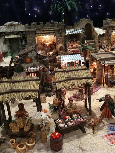 Fontanini Christmas nativity display ideas. City market scene. Meat cutter, basket weaver, pottery shop.