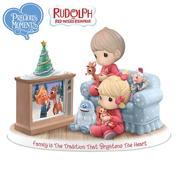 "Limited edition! Handcrafted bisque porcelain Precious Moments® figurine celebrates watching Rudolph the Red-Nosed Reindeer each holiday season. Measures 6"" H, Family Is The Tradition That Brightens The Heart Figurine Price:99.96"