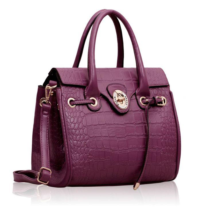 Geanta Purple Croc Satchel ~ Geanta de mana medie din piele eco de inalta calitate, cu design modern si inchidere in clapeta. Partea inferioara a gentii este intarita si protejata de deformari. Interior din material satinat cu compartimente si buzunare. Saculet textil pentru pastrare si transport. Dimensiuni :  31 cm baza, 28 cm inaltime. #gentiieftineonline #culoareaanului2014