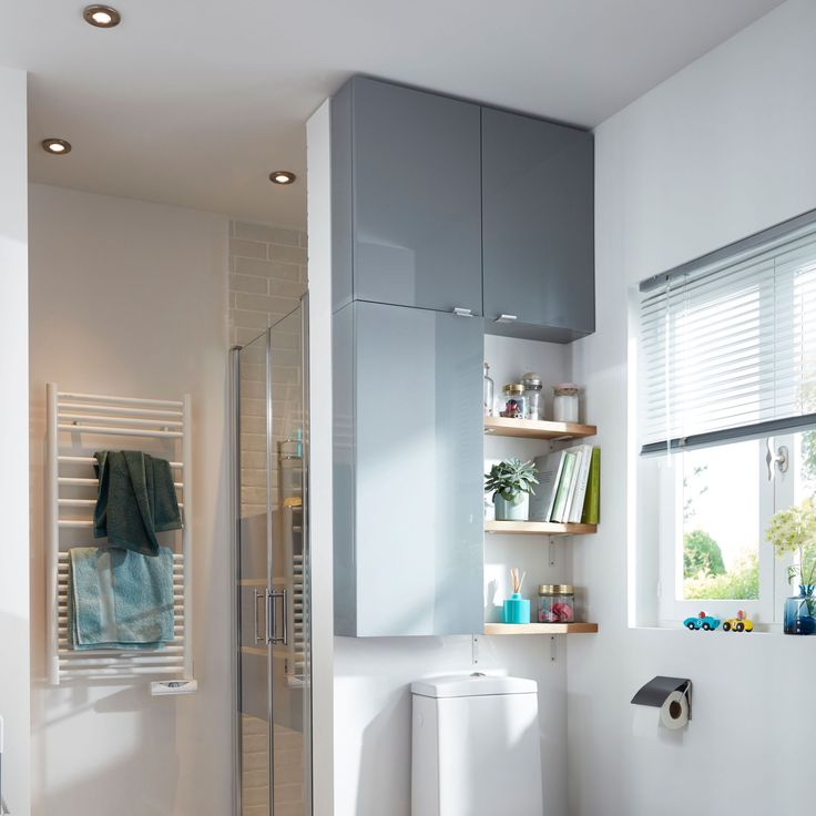 Get Organised - Bathroom Storage Ideas & Tips   Open shelving used in conjunction with a slimline cupboard not only allows you to store away the bland essentials of the bathroom but allows you to add some interest by way of accessories. #bathroom #bathroomstorage #bathroomdesign #bathroomideas #storage #shelving #homedecor #interiors