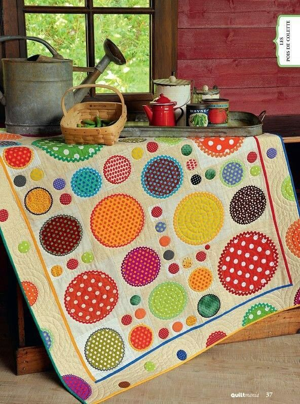 Pretty quilt looks like rick rack around the circles. How Totally Fun this Quilt is !!B