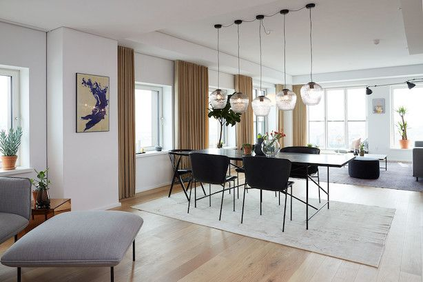 The Dining/Living room of the first apartment at Carlsberg Byen in Copenhagen. HANDVÄRK Dining Table, Friends and Founders chairs, HANDVÄRK Coffee Table & lots of Louise Roe accessories.