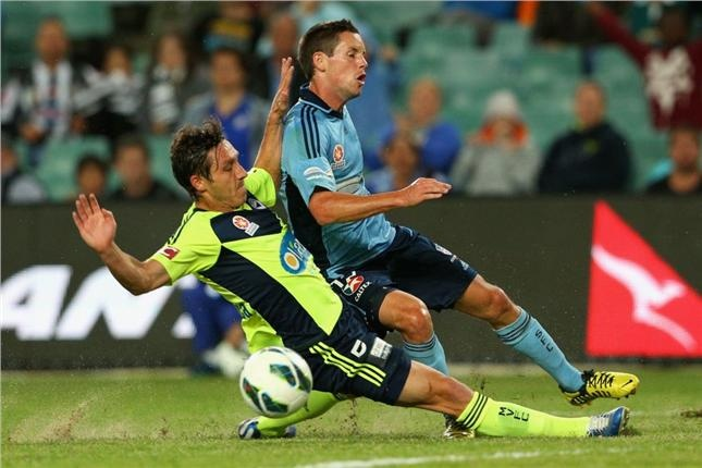 Powell tackled by ex-Sydney FC man Milligan as Melbourne Victory mount a comeback to win 2-3