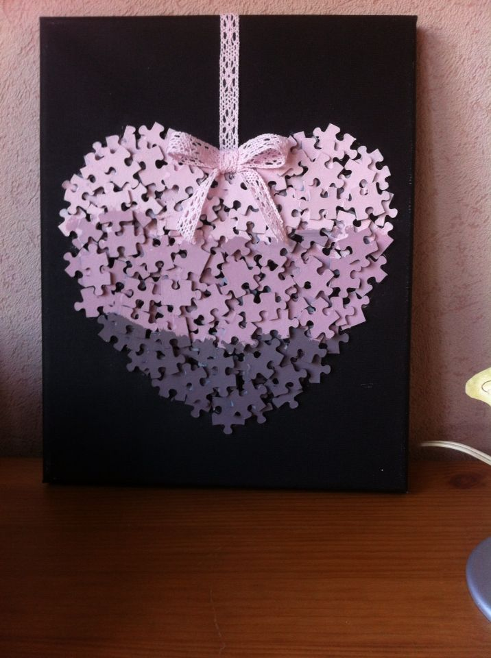 Pink Puzzle heart. Recycle & paint puzzle pieces pink, glue onto cardboard background, hang from satin ribbon.