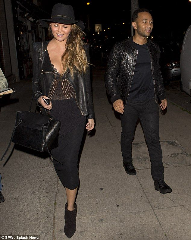 Sexy style: Chrissy showed off her curvaceous figure in a plunging see-through blouse...