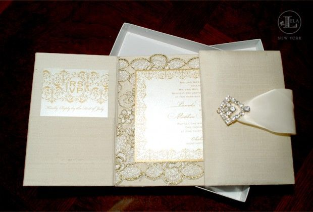 Lela New York designed Pamela's Silk Gatefold folio wedding invitations in a beautiful ivory and gold with an Austrian crystal closure. Pam was getting married in Oheka Castle and wanted an elegant and romantic look. We combined gold printing and lace embellishment to accomplish her couture wedding invitation's style of royal elegance and luxury that set the tone for her wedding.