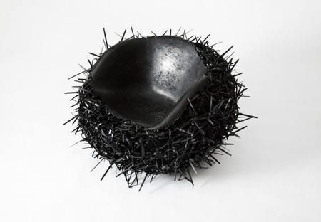 Meltdown Chair made from 10,000 melted black cable ties // tom price