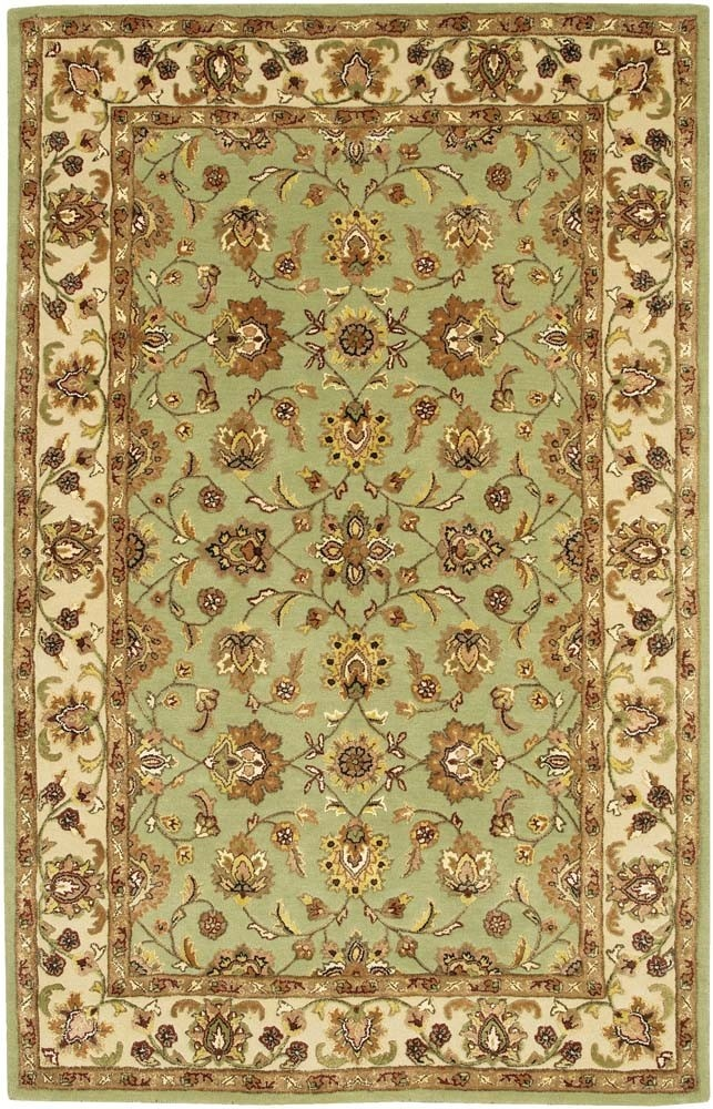 mint green oriental rug with brown tan walls gold cream