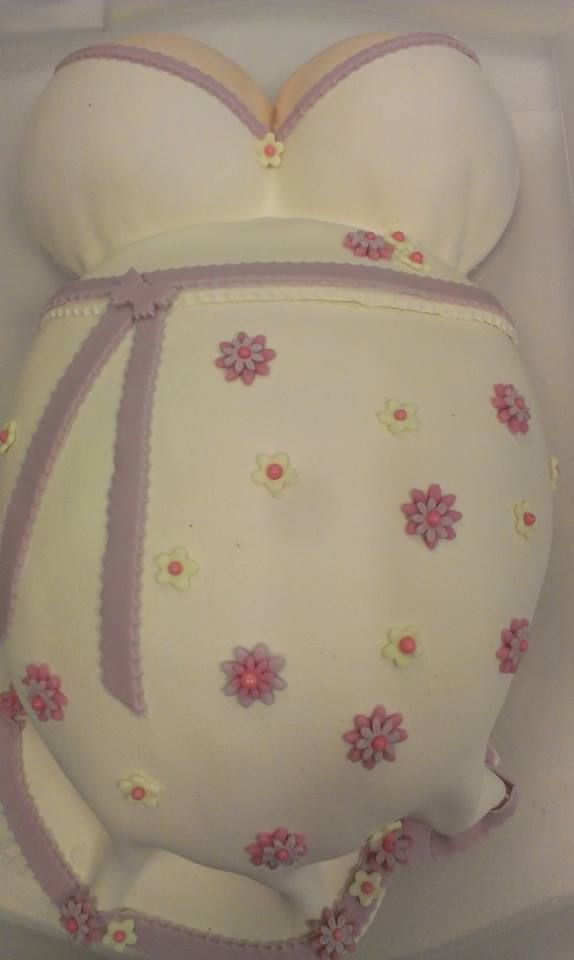 Pregnant. Cake filled with confiture and buttercream. Marzipan and fondant dress.
