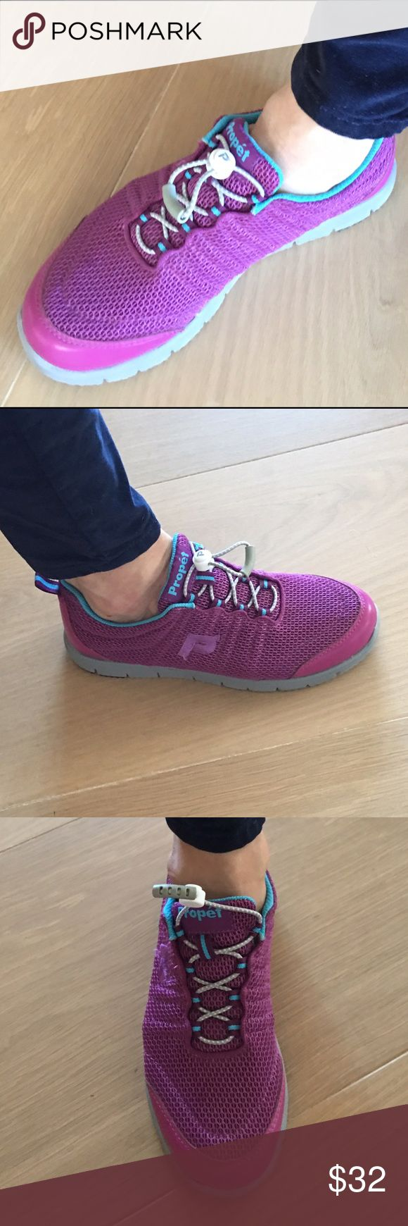 Propet TravelWalker II sneakers worn only once This is a great pair of comfortable walking shoes. Size 8 fun color sort of a combo purple and hot pink with blue trim. Like new they were only worn once! Propet Shoes Athletic Shoes