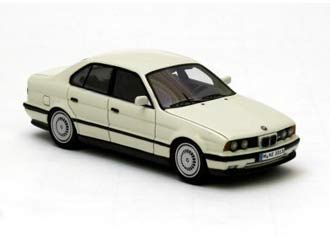This BMW M5 E34 (1994) Resin Model Car is White and features working wheels. It is made by Neo and is 1:43 scale (approx. 10cm / 3.9in long).  ...