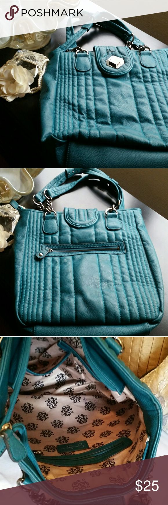 "Large Teal Jessica Simpson Tote Large Jessica Simpson tote bag! Beautiful teal color! Pre-loved do there is wear around the straps and the closing buckle area (pics 4, 5, & 6) and small interior wear (pic 3). Overall still in decent condition. Approximately 12"" long, 13"" high & 4.5"" wide with about 10"" strap height. Jessica Simpson Bags Totes"