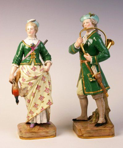 A very rare pair of Meissen figures of a huntsman