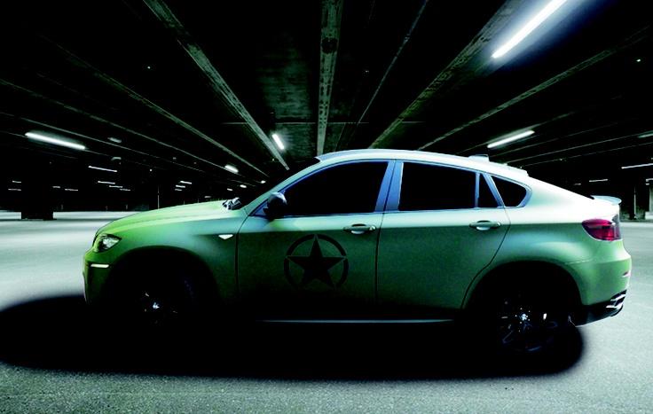 Wrapping bmw x6 tramite pellicola verde militare e particolari in adesivo prespaziato nero opaco.  www.guidoborgonovo.it