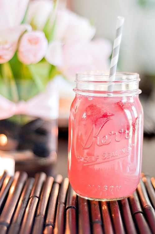 raspberry beer lemonade: 1C raspberries, 4 bottles corona, 1 container frozen raspberry lemonade or pink lemonade, 1/2C vodka. Garnish: lemon slices or raspberries