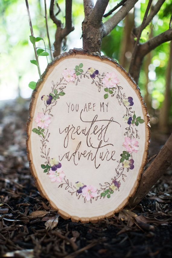 custom designed wood burned sign with a wreath of wood burned leaves and pressed flowers and greenery.