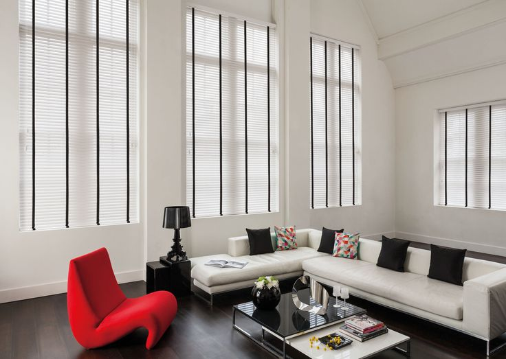 White Wooden Blinds With Black Tapes In A And Room