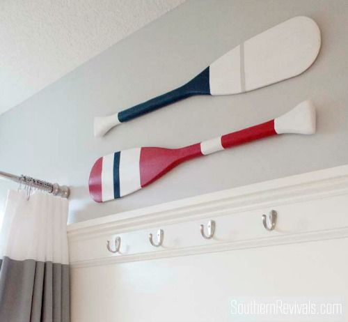 DIY Painted Oars Wall Decor inspired by Pottery Barn: http://www.completely-coastal.com/2016/06/coastal-nautical-small-bathroom-makeover-diy-ideas.html