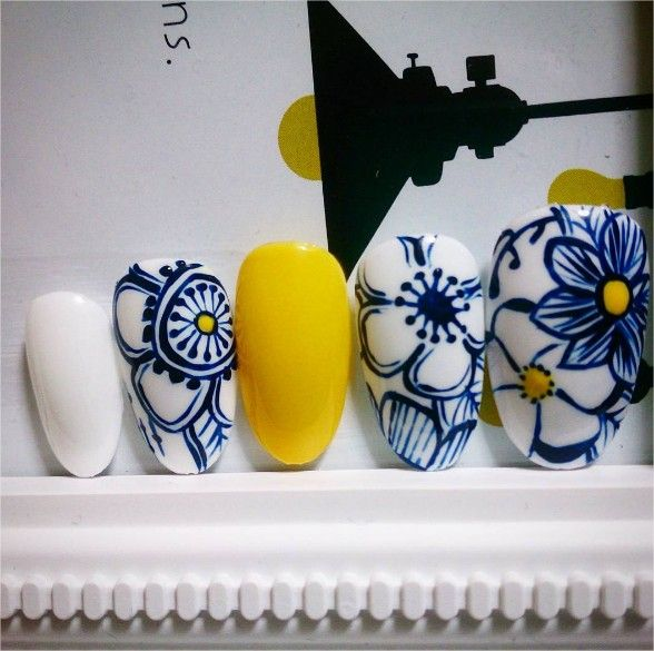 Blue floral, yellow and white nails. So summery and fresh!