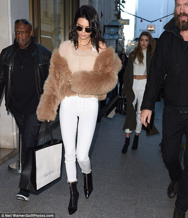 Well protected: Kendall kept herself warm in the chillier European weather with a classically chic tan fur jacket as she stepped out with Gigi and the security team