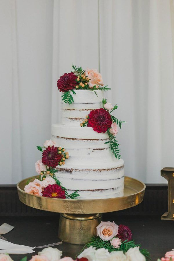 Romantic floral topped naked cake: http://www.stylemepretty.com/california-weddings/san-juan-capistrano/2016/05/10/flamenco-flair-steals-the-show-at-this-southern-california-wedding/ | Photography: Mark Brooke - http://markbrooke.net/