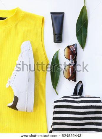fashion blogger concept. Minimal set of Feminine accessories on white background.