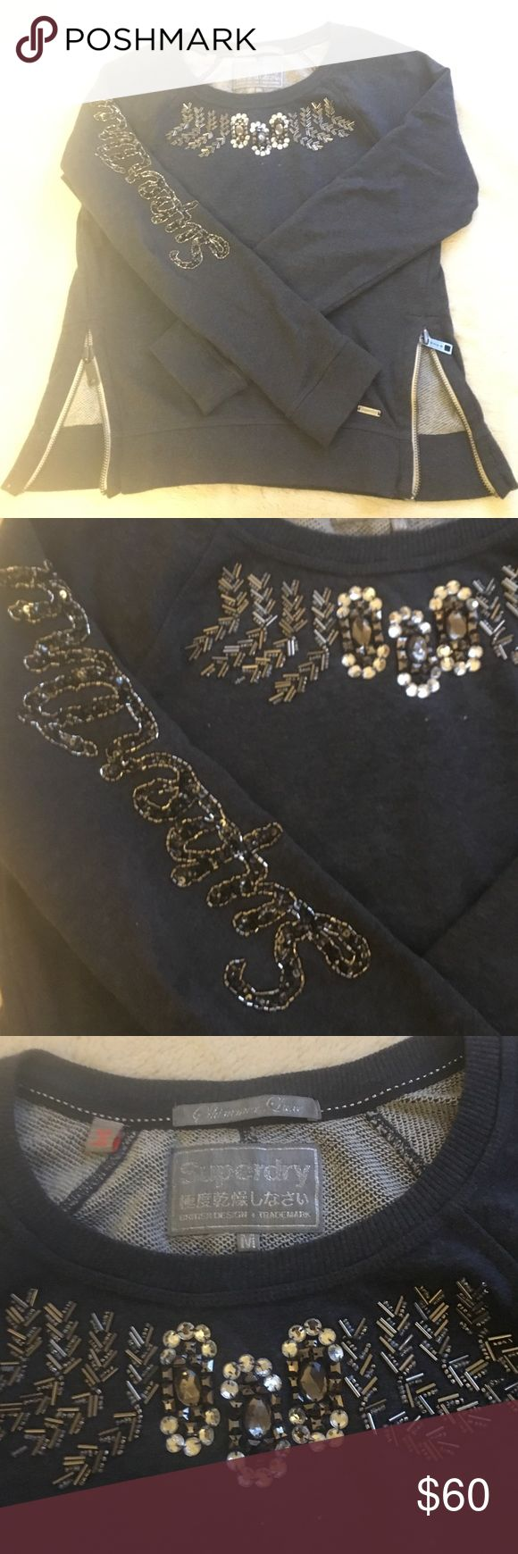 """Superdry Navy Embellished Sweatshirt M Navy, Rhinestone embellishment, """"Superdry"""" logo in sequins on one arm, functional side zippers. Size M absolute perfect condition NWOT Superdry Tops Sweatshirts & Hoodies"""