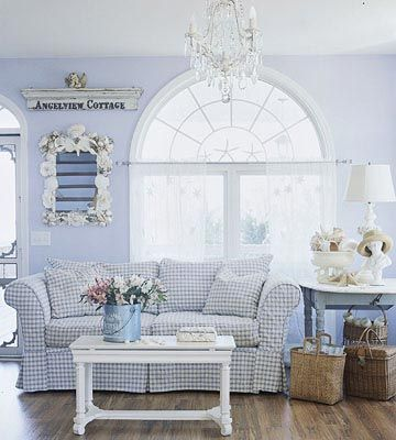 Love the cottage feel and warm woodsy accents. The plaid couch is a winner for sure!