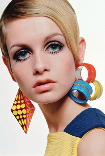 1960s jewelry trends: Fashion model Twiggy wearing a selection of plastic jewelry designs in 1967.